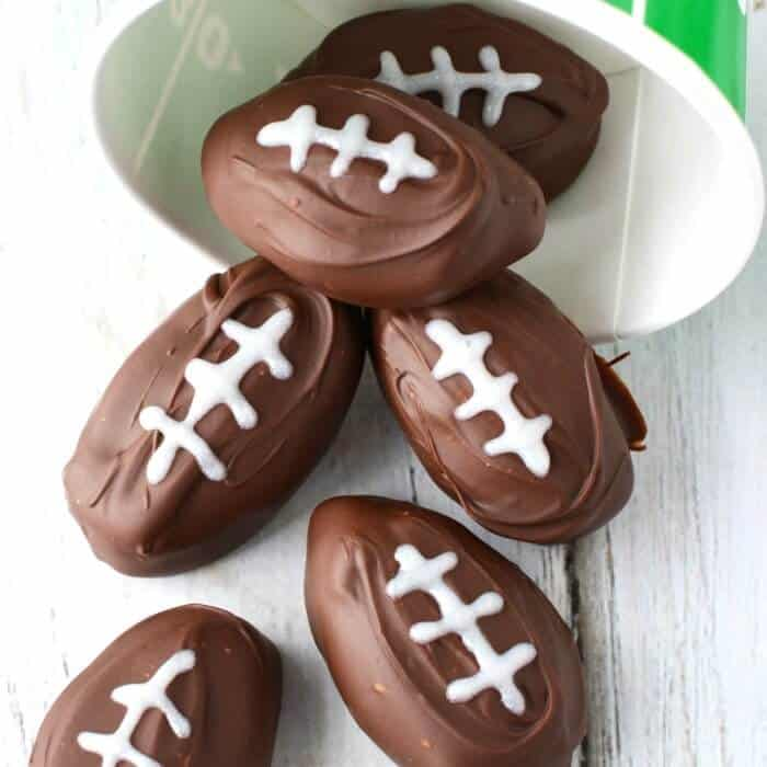 Chocolate peanut butter football shaped dessert with icing for the laces.