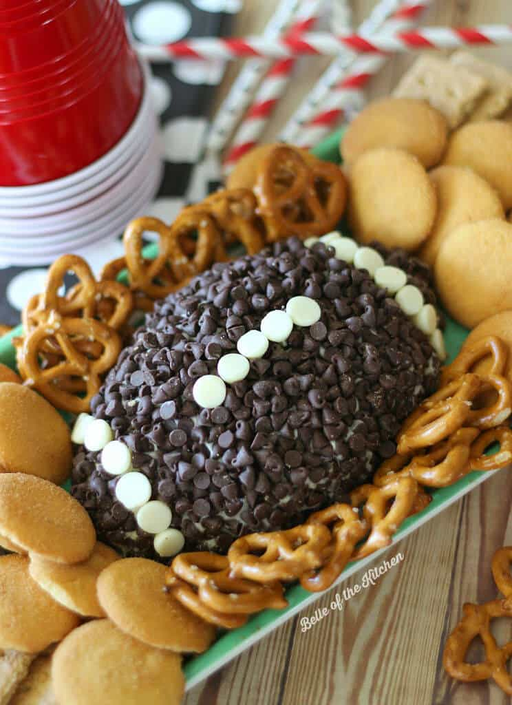 a cheesecake mold shaped into a football coated with chocolate chips.