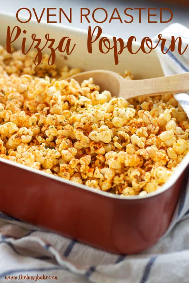 seasoned popcorn in a dish with a spoon.