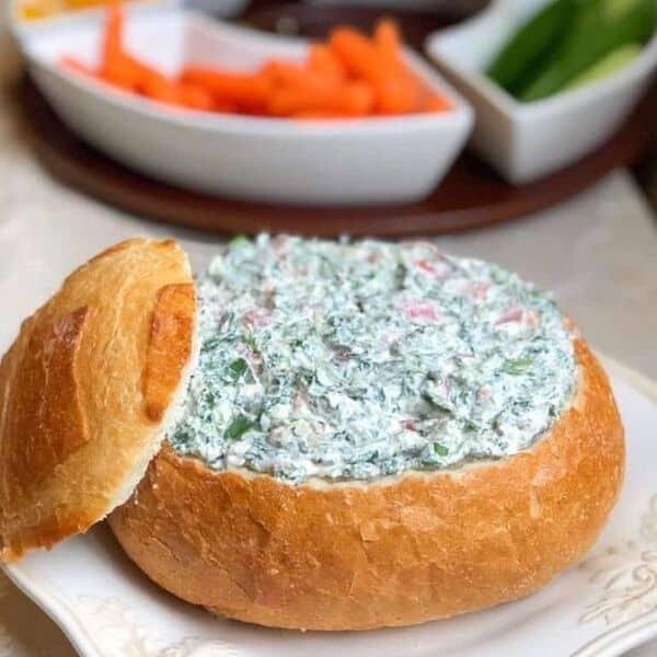 Cream cheese dip inside a bread bowl.