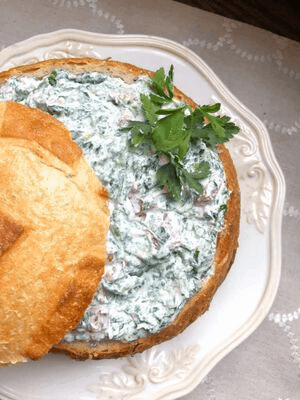 cold creamy spinach dip inside of bread bowl without mayo