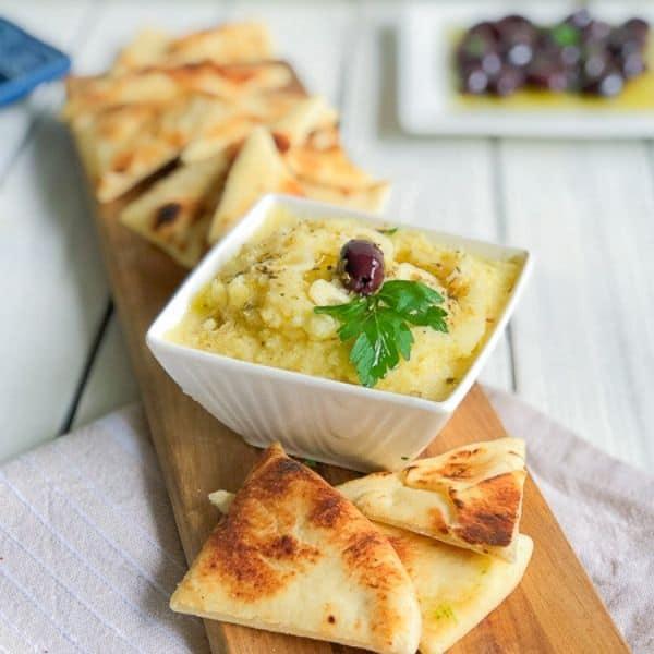 Skordalia in a bowl served with pita bread.