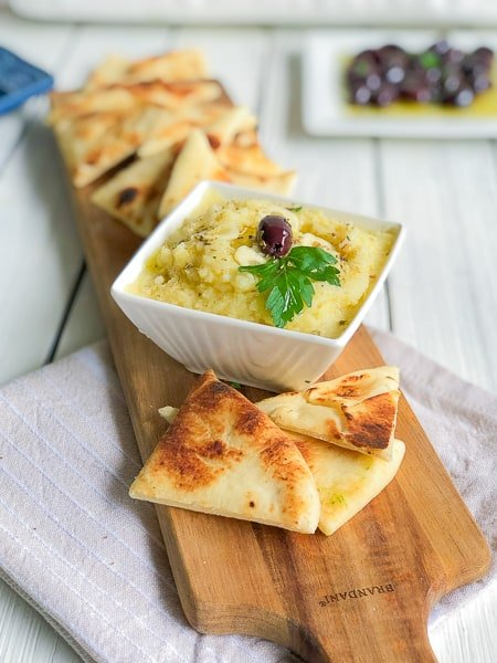 Greek potato dip with pita bread on the side.