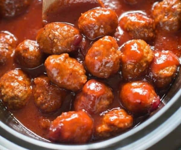 Cranberry BBQ meatballs in a slow cooker.