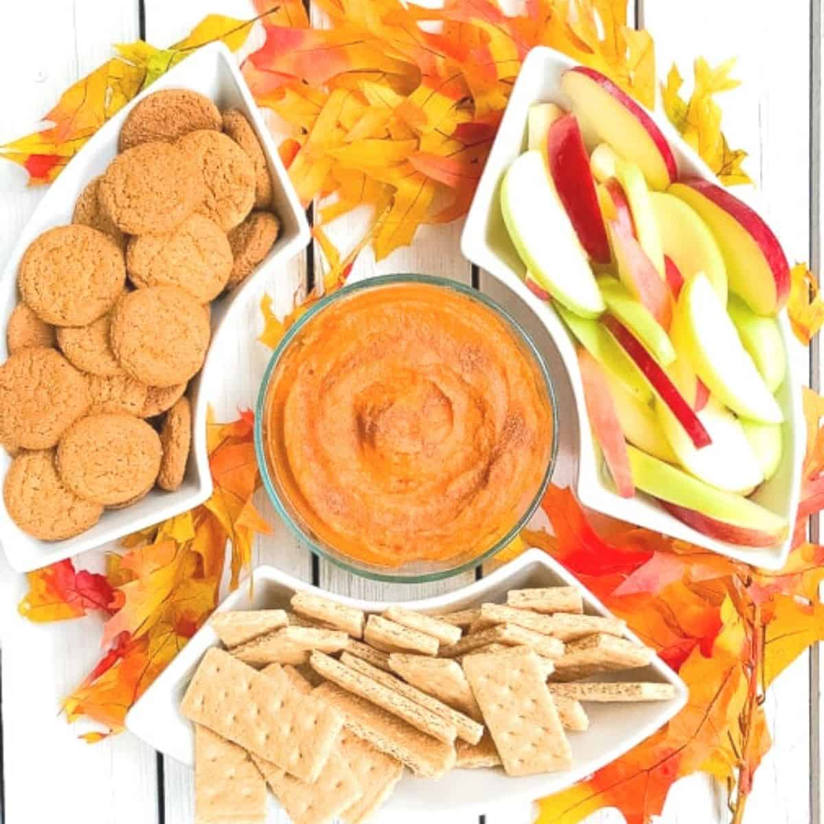 pumpkin puree dip with gingersnap cookies and apples