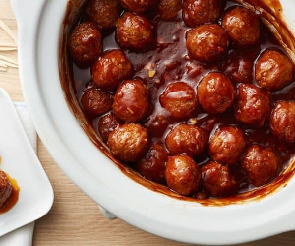 Meatballs in a BBQ sauce inside a slow cooker.