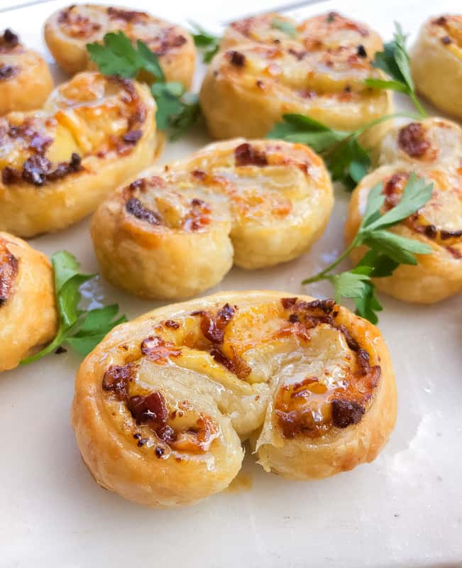 puff pastry palmiers with bacon and cheese on a plate