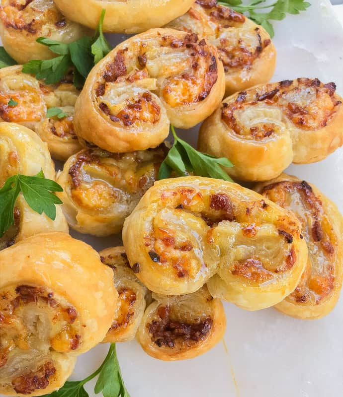 A stack of savory palmiers on a plate.