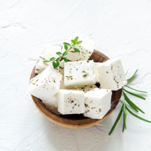 Cubes on feta cheese on a bowl.