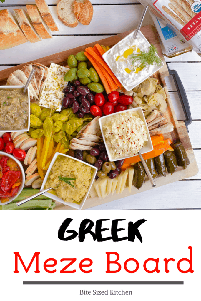 Mediterranean meze spread with Greek dips and appetizer board.