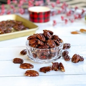 glazed pecans in a glass bowl: a holiday finger food snack