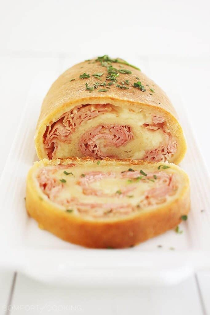 ham and cheese roll ups sliced on a plate