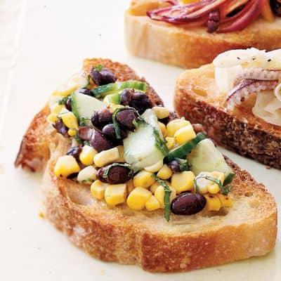 corn salsa with beans over crostini