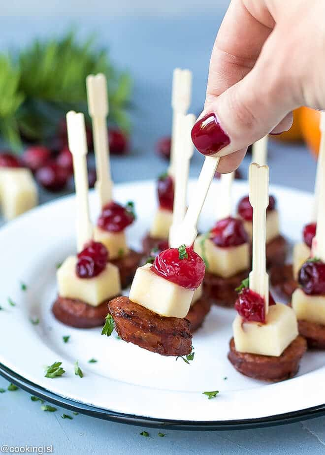sausage cheese and cranberry skewers on a plate