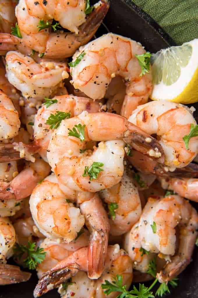 garlic shrimp with lemon wedge in bowl