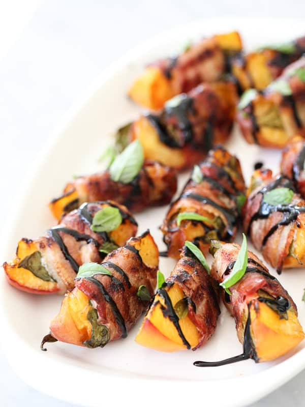 peach slices wrapped in bacon drizzled with balsamic vinegar