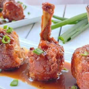 chicken drumsticks frenched into lollipops with sauce