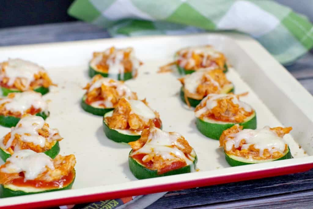 buffalo zucchini appetizers on rounds with melted cheese on top
