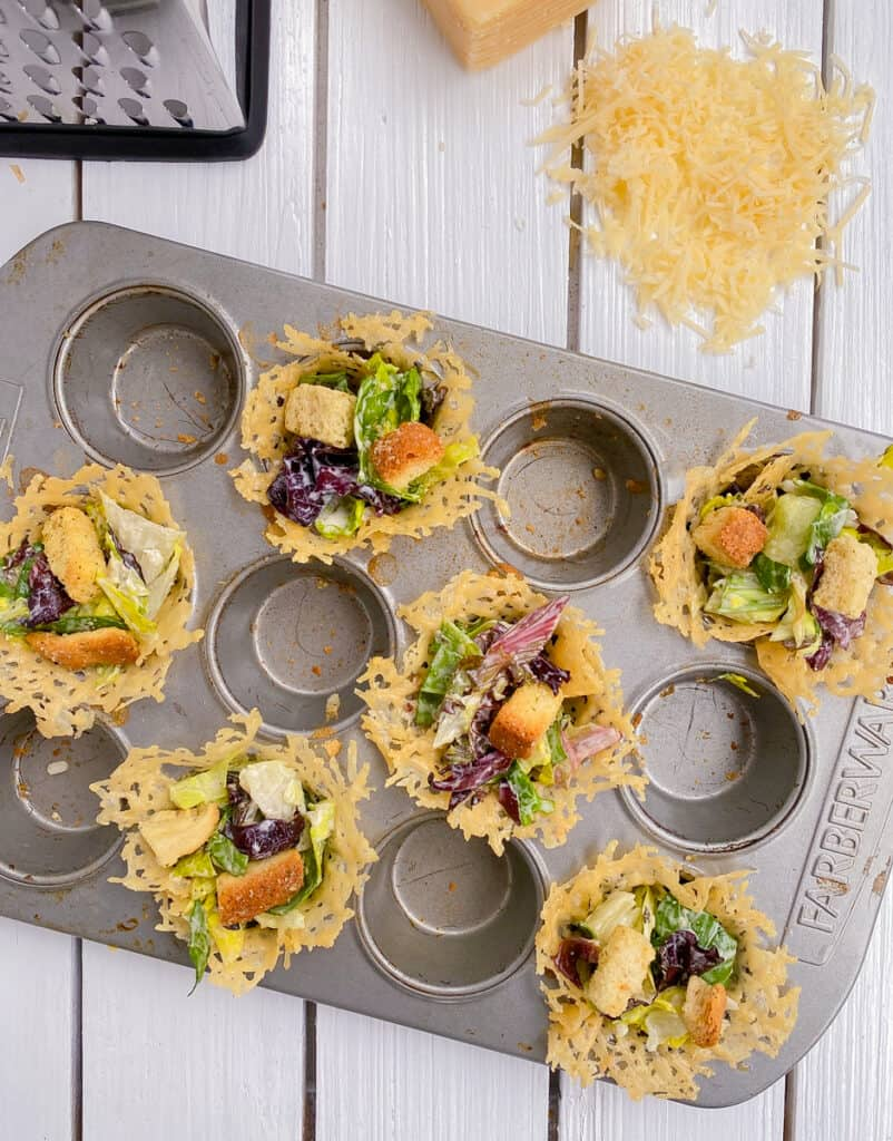 baked parmesan cheese cups filled with salad