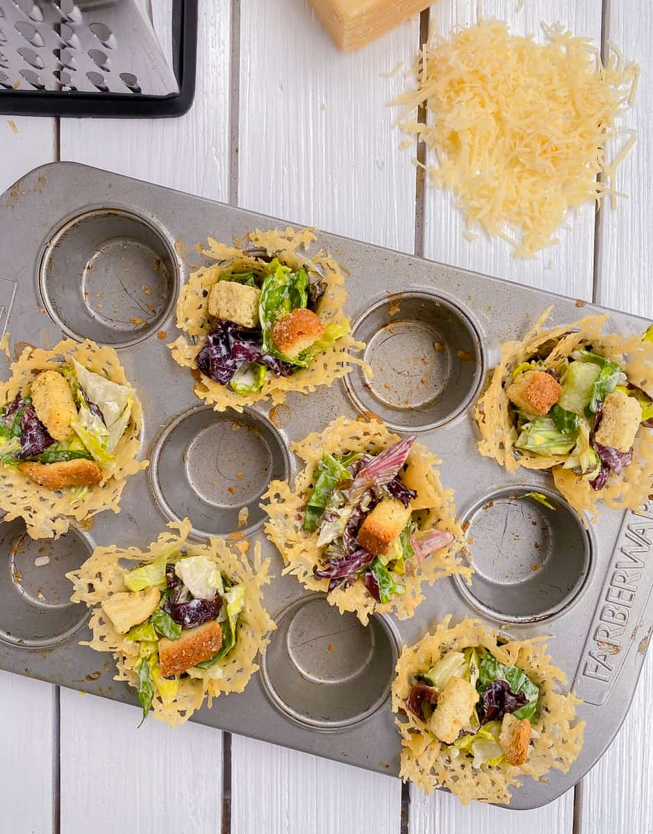 baked parmesan cheese cups filled with Caesar salad.