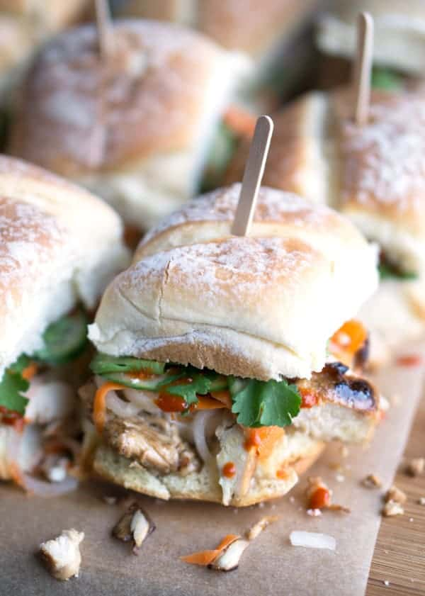 chicken party sliders with a skewer in the middle on a table