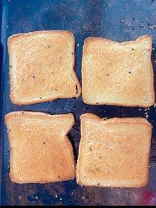 baked shrimp toast on a baking sheet.