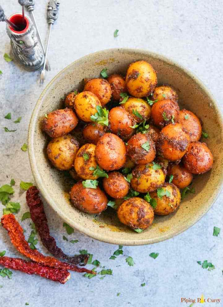 easy instant pot appetizer potatoes with seasoning on top in a bowl