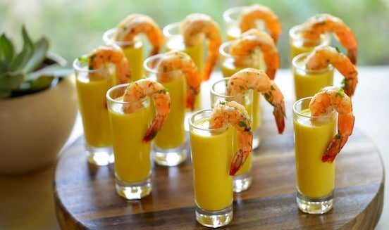 shrimp appetizer shooters with yellow soup inside