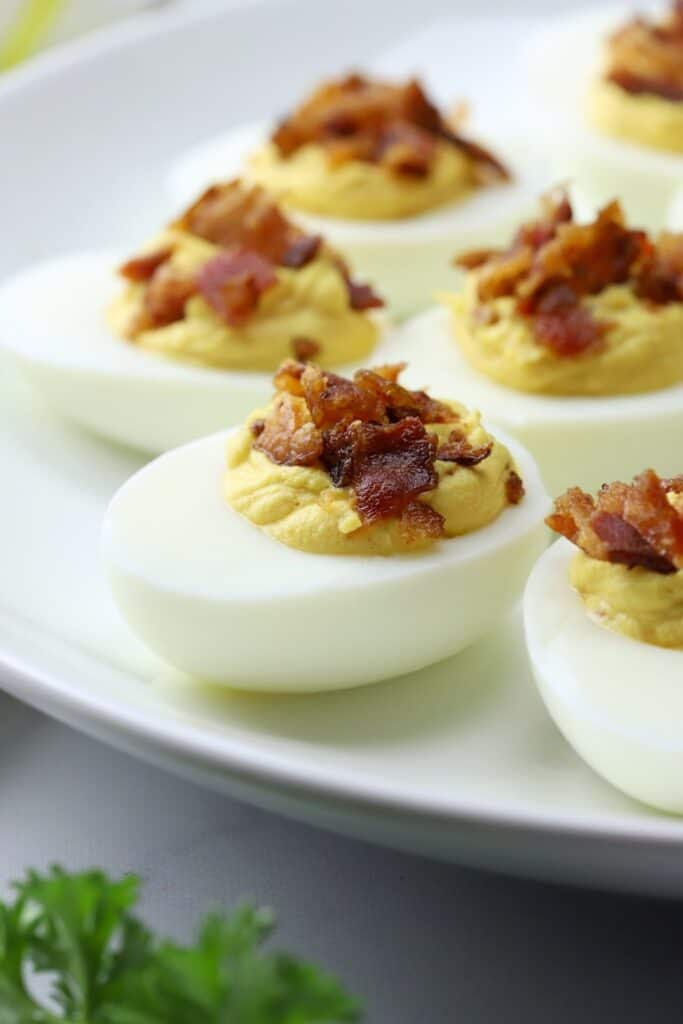 bacon deviled eggs appetizer on a plate