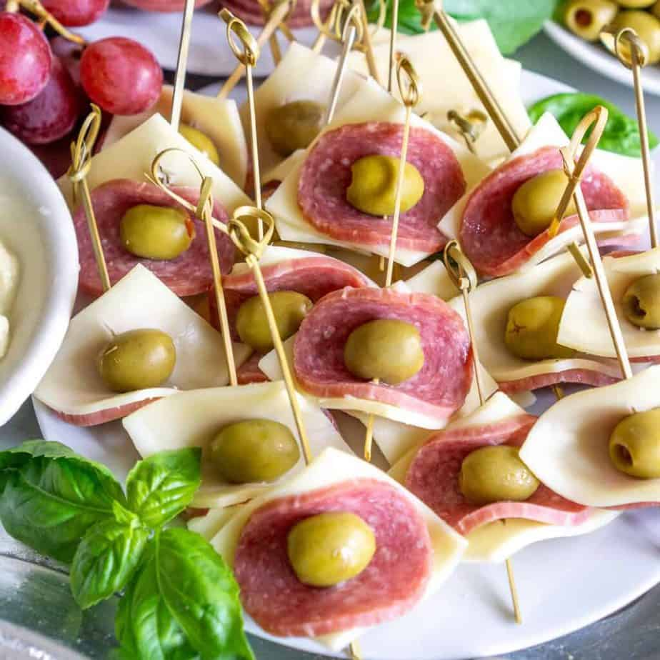 skewered salami and cheese appetizer bites on a plate