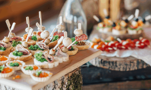 easy party finger foods on wooden planks on a buffet table
