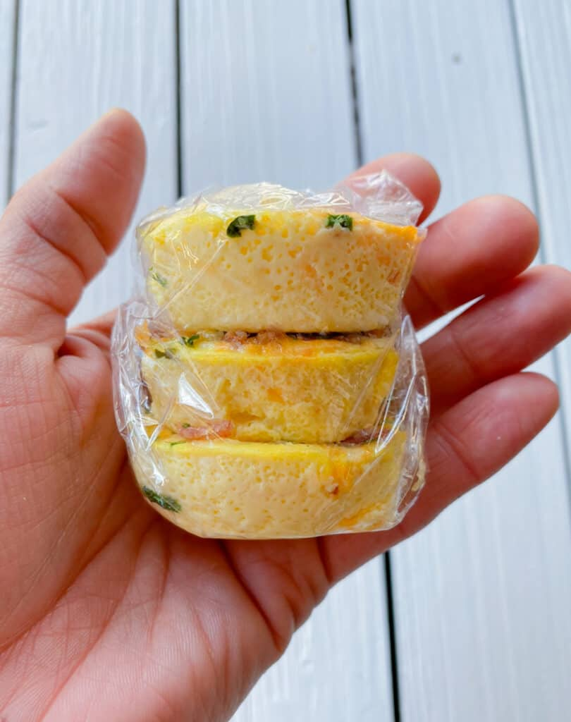 egg bites wrapped in plastic wrap for freezer