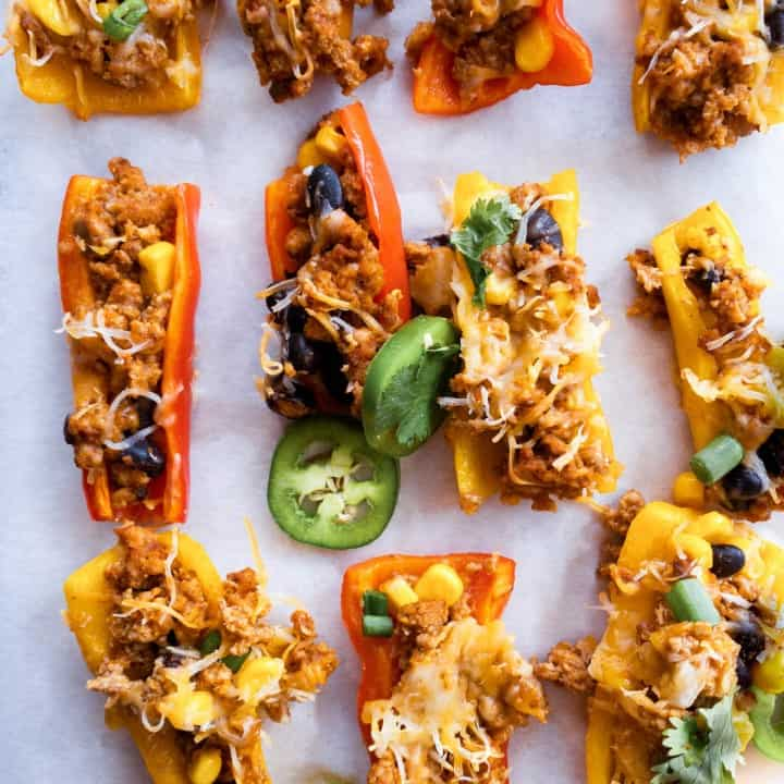 yellow and orange stuffed mini peppers appetizer with ground turkey