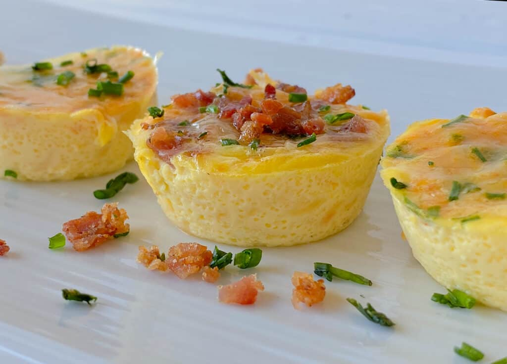 mini egg cups on a white plate