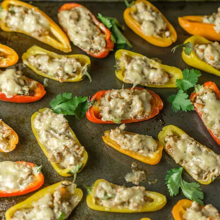 baked shrimp and bell peppers stuffed appetizer on a baking sheet