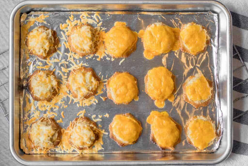 tuna melt bites on a baking sheet with melted cheese