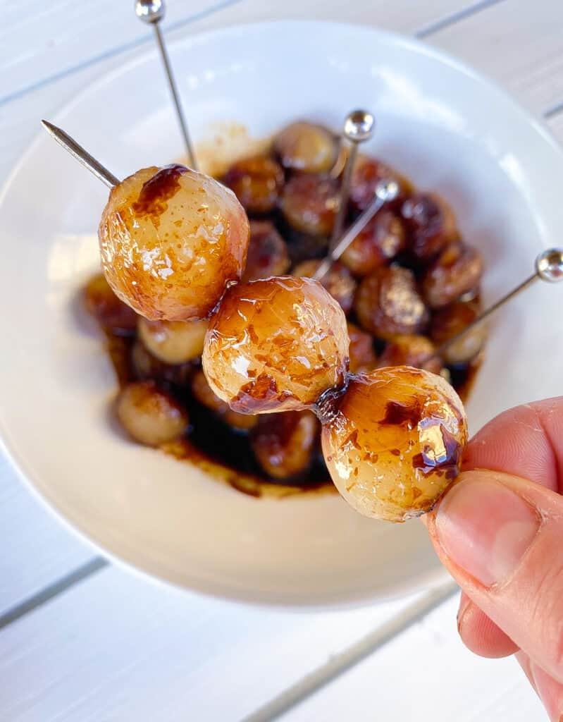 caramelized pearl onions on a skewer