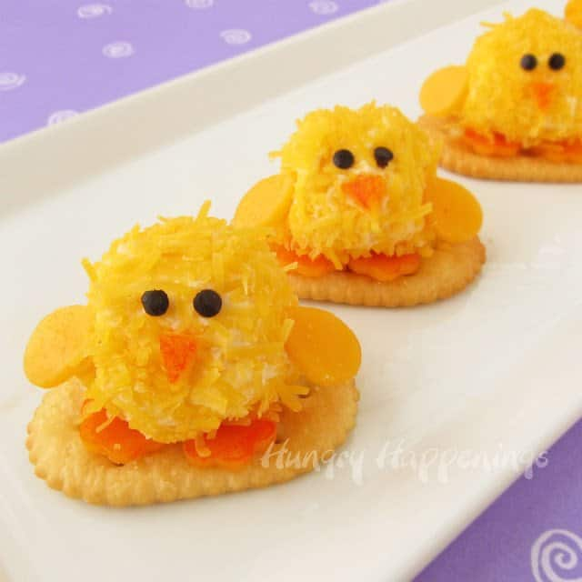 cheese rolled in cheddar to look like a chick for a finger food.