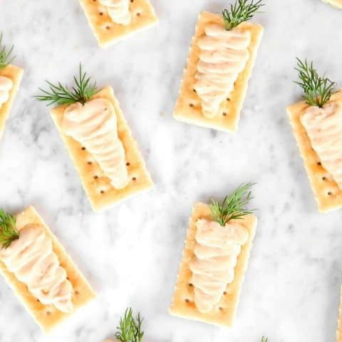 crackers with cheese piped into carrots appetizer for Easter.