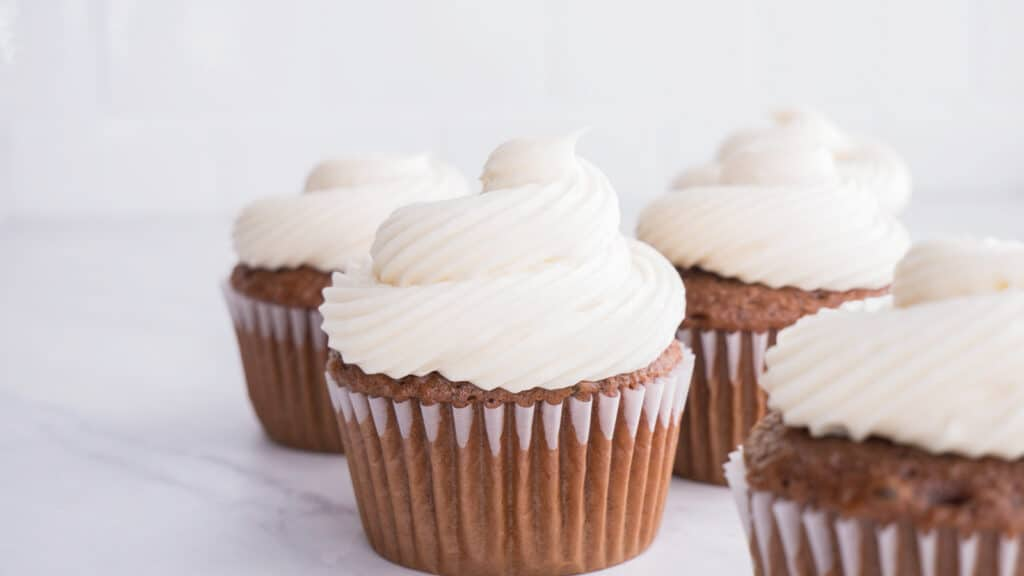chocolate cupcakes with white powdered sugar frosting
