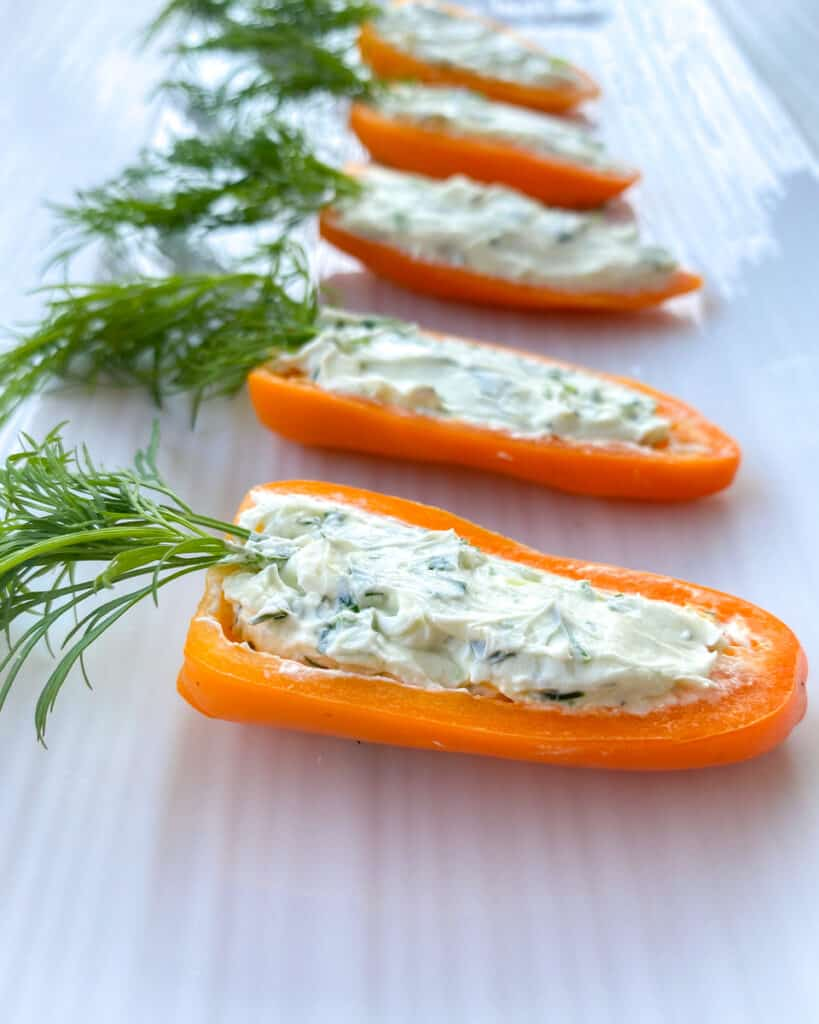 stuffed orange peppers with dill leaves