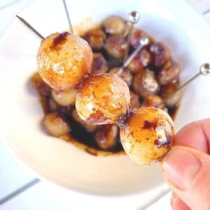pearl onions with balsamic vinegar on a toothpick skewer