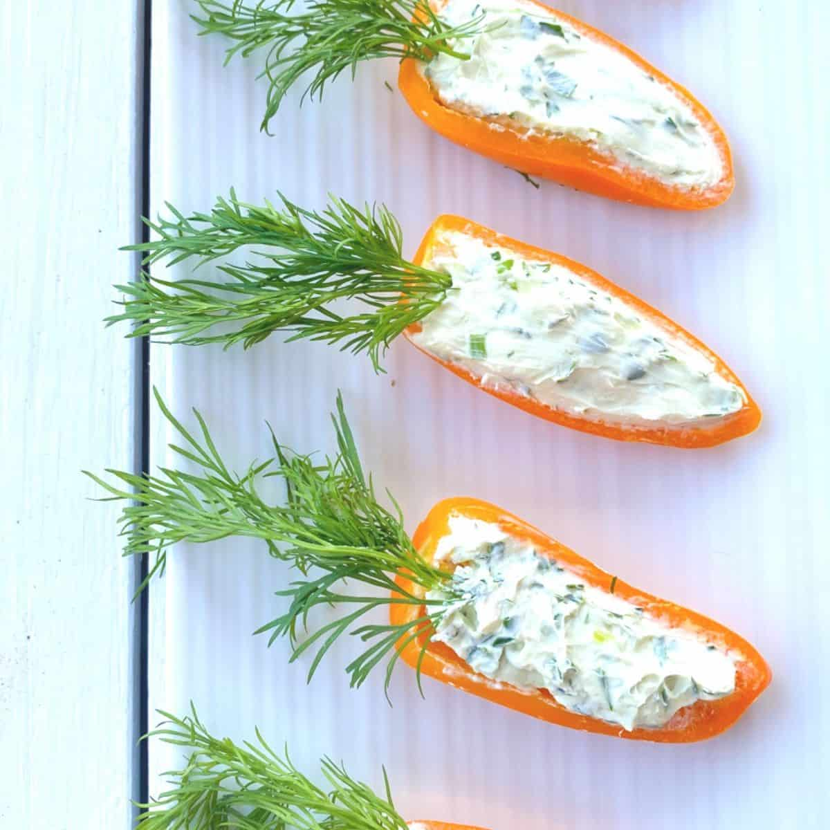 orange mini peppers stuffed with cream cheese on plate