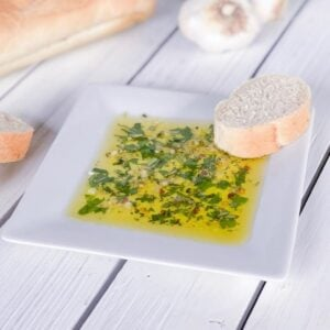 olive oil dip with fresh herbs on a plate