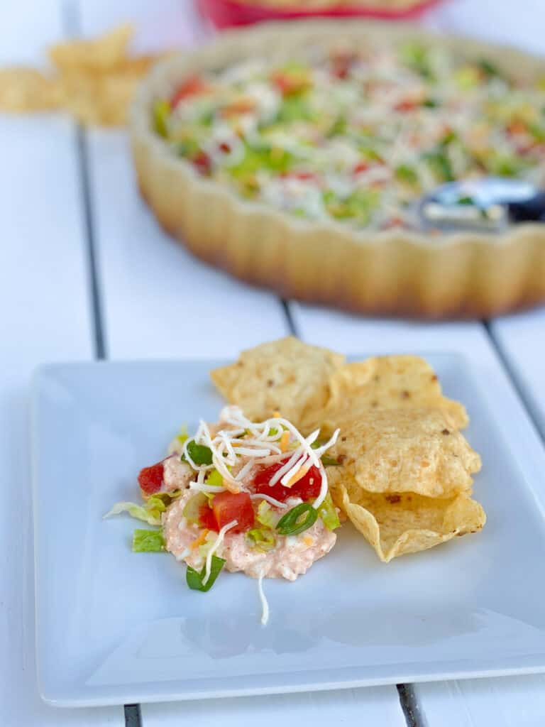 cottage cheese taco dip on a plate with corn chips