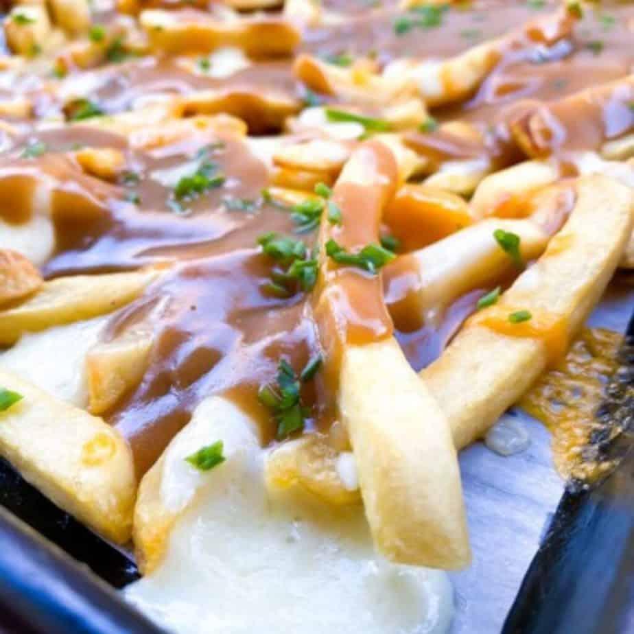 gravy fries on a baking sheet