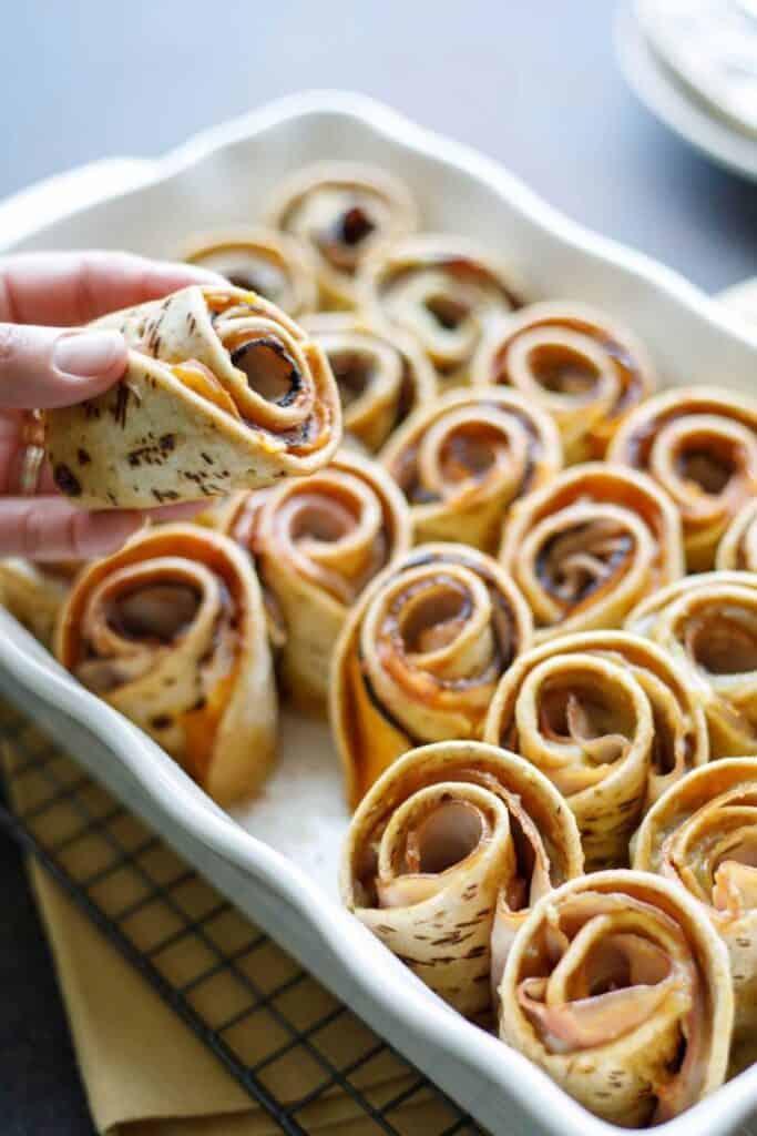 "rolled hawaiian roll ""sliders"" in a baking dish"