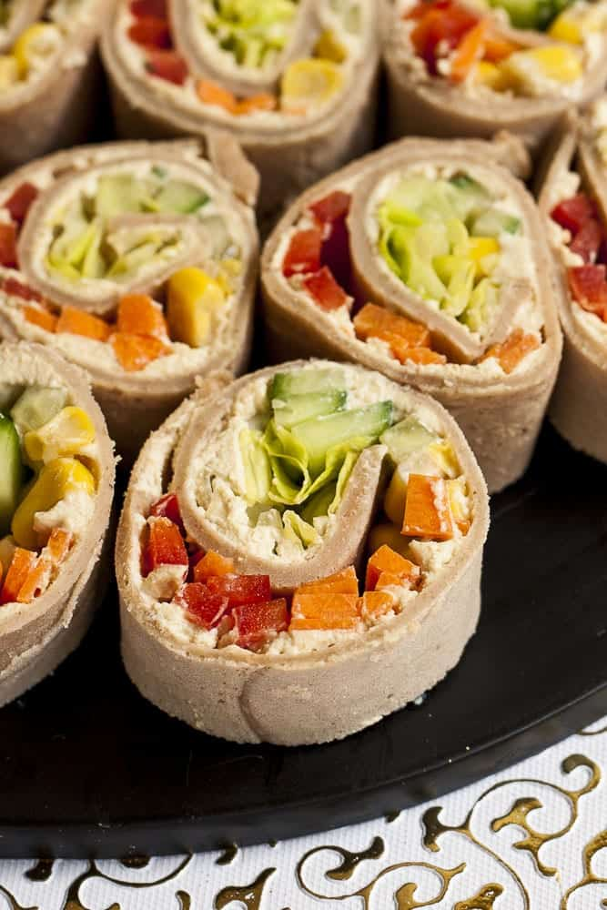cream cheese and veggie pinwheels sliced on a plate