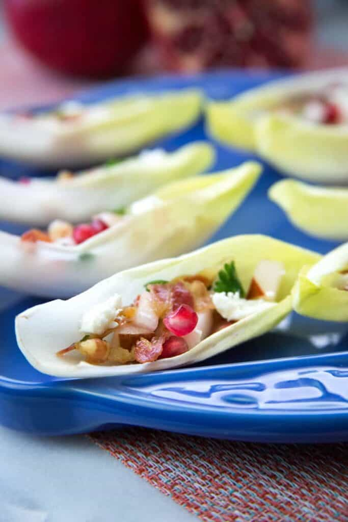endive leaves stuffed with pancetta and pomegranate seeds