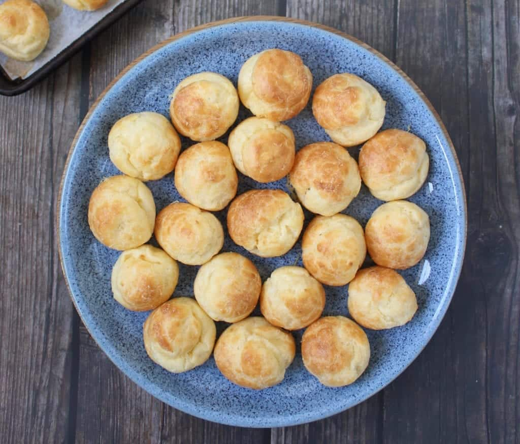 cheese gougeres on a blue dish
